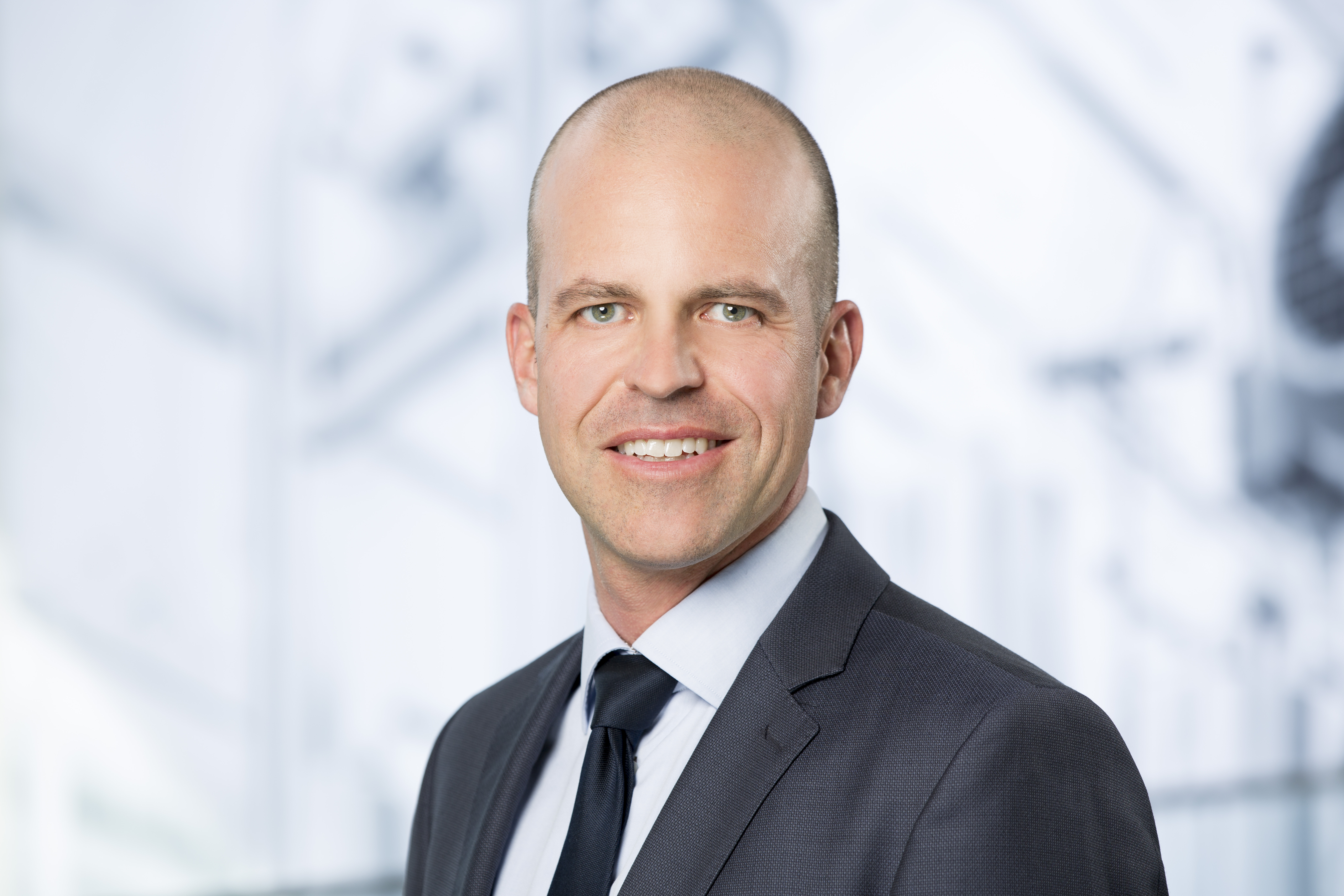 portrait of Marcel Härtlein, Global Head Transformation at the Emmi Group